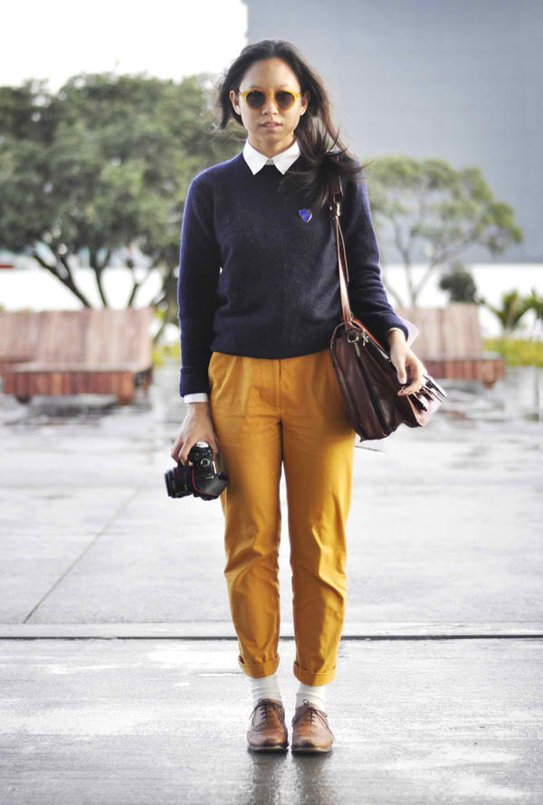 Pants paired with white collared shirt and a blue sweater