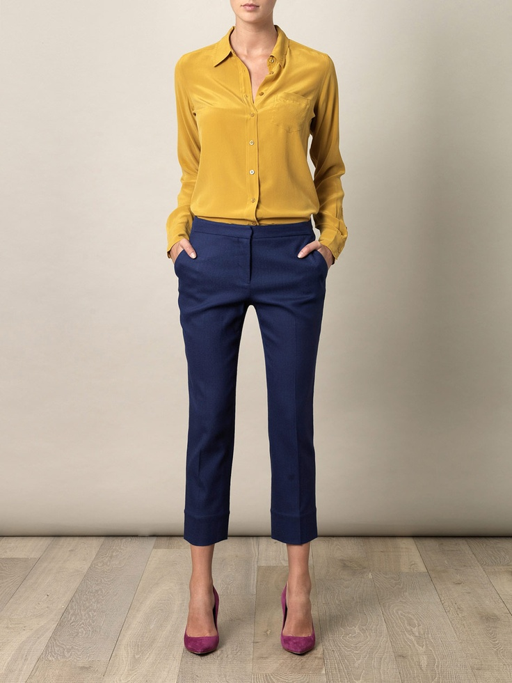 Mustard shirt paired with dark blue pants and a pink suede heels for a subtle pop of colour