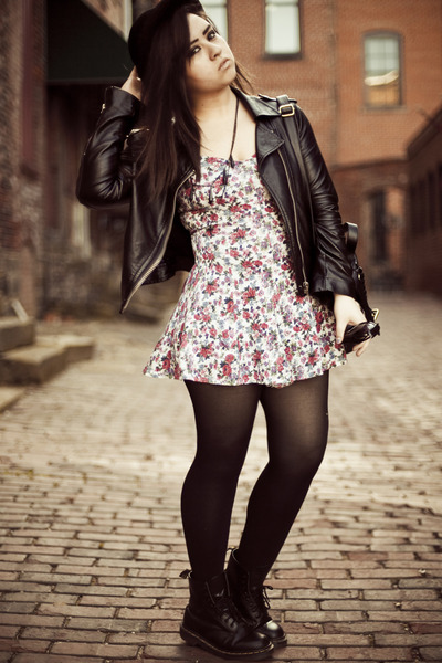 The model has paired her floral dress with the jacket and transparent leggings.
