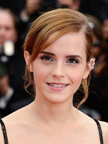 Emma Watson wearing ear cuffs.