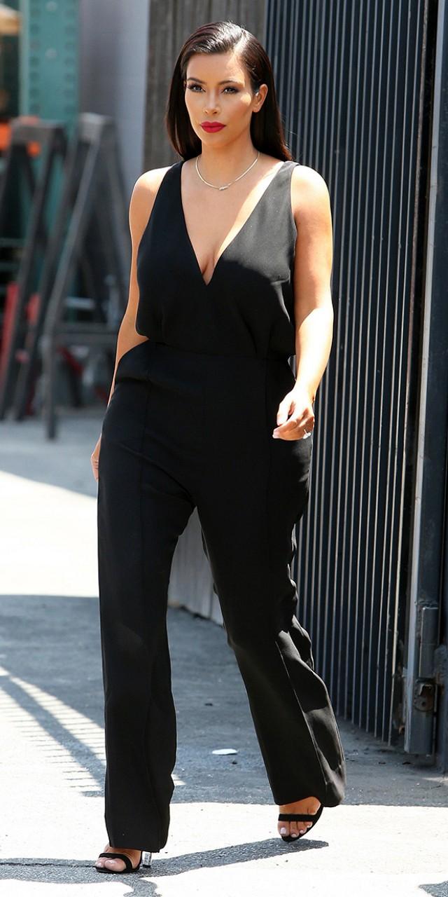 Kim Kardashian in black jumpsuit.