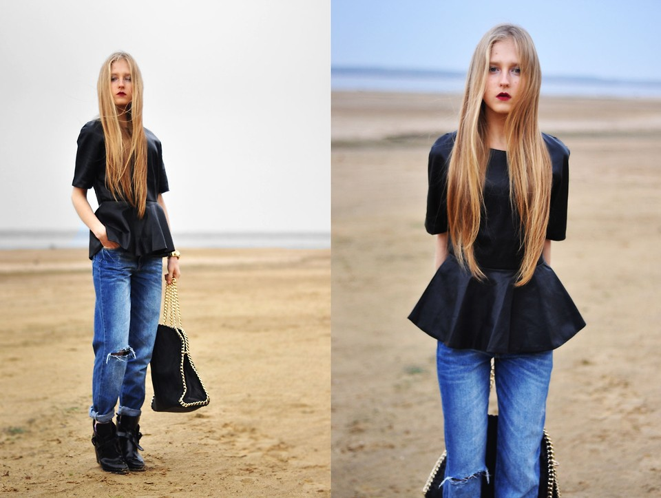 The model in Boyfriend Jeans and Peplum top.