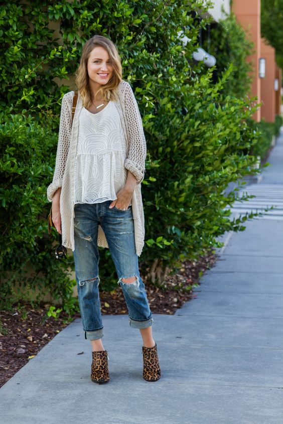 The model in Boyfriend Jeans with Tank, Cardigan, and Leopard booties.