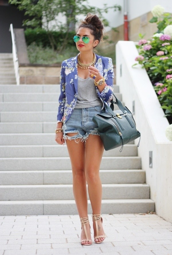 The model in Denim Shorts Outfit with a Blazer.