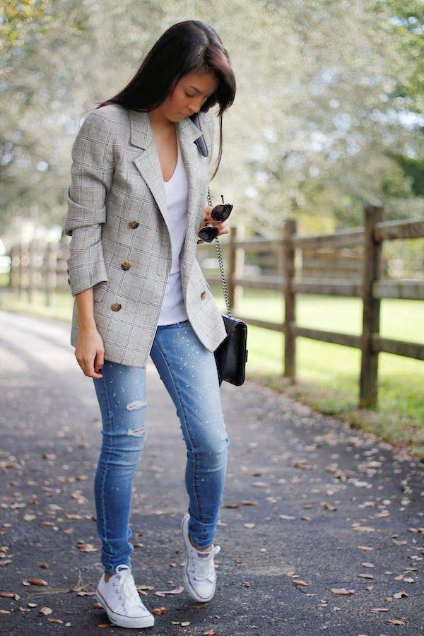 The model in Blazer with Denim Jeans.