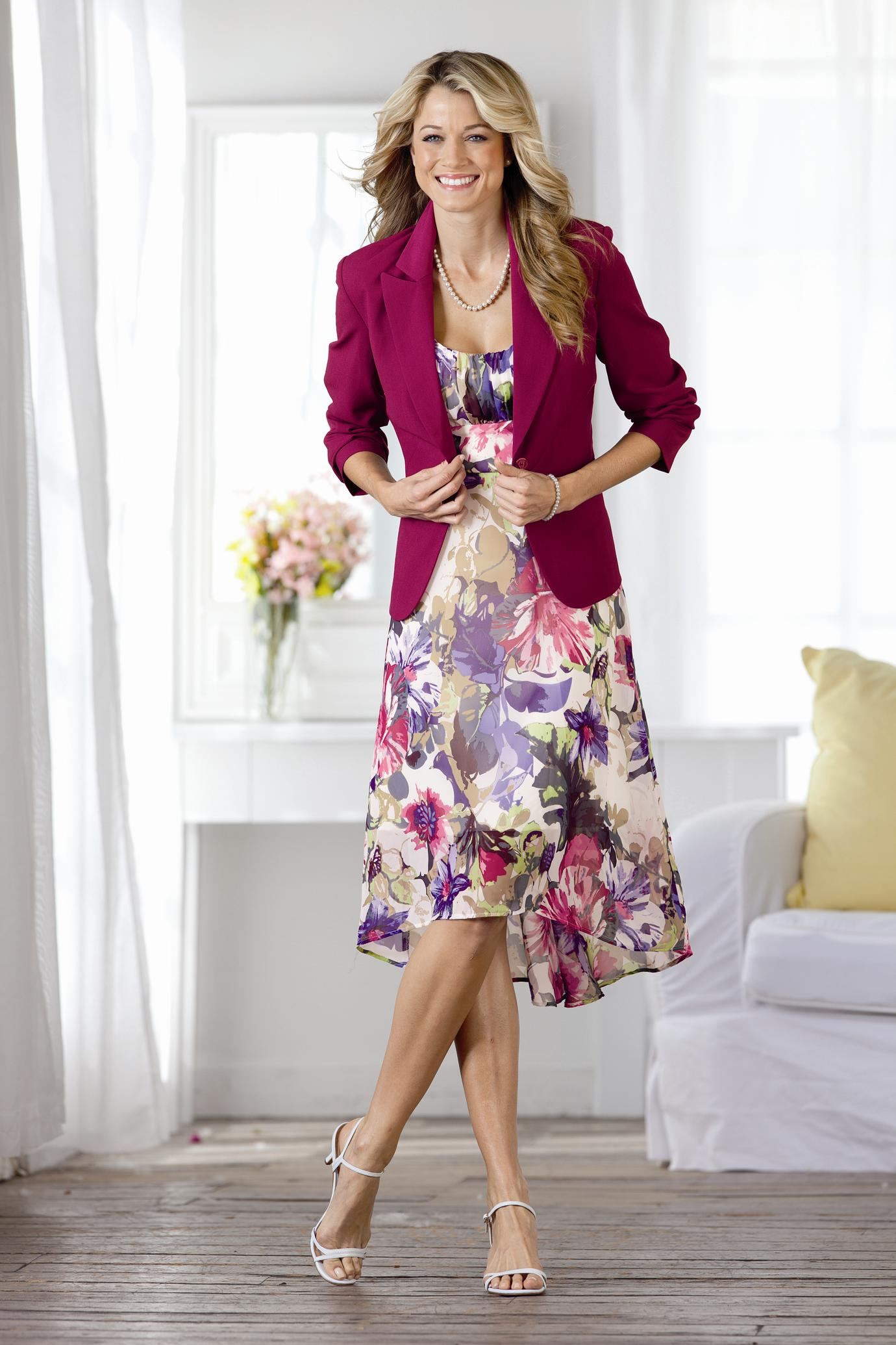 The model in dress with blazer.