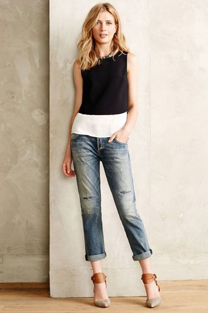 The model in Boyfriend Jeans With a Slim Tee.