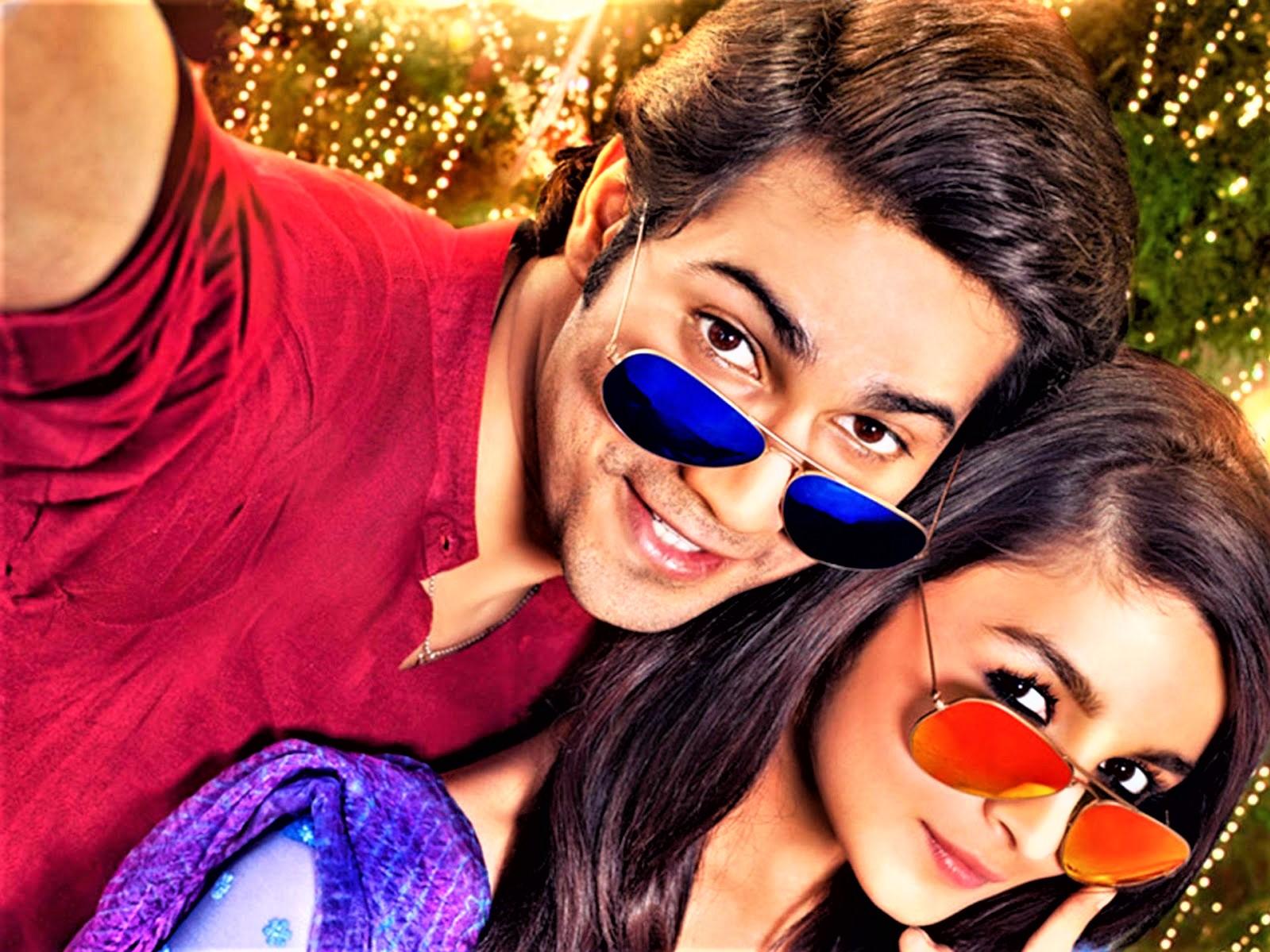 Varun Dhawan and Alia Bhat with aviator sunglasses.