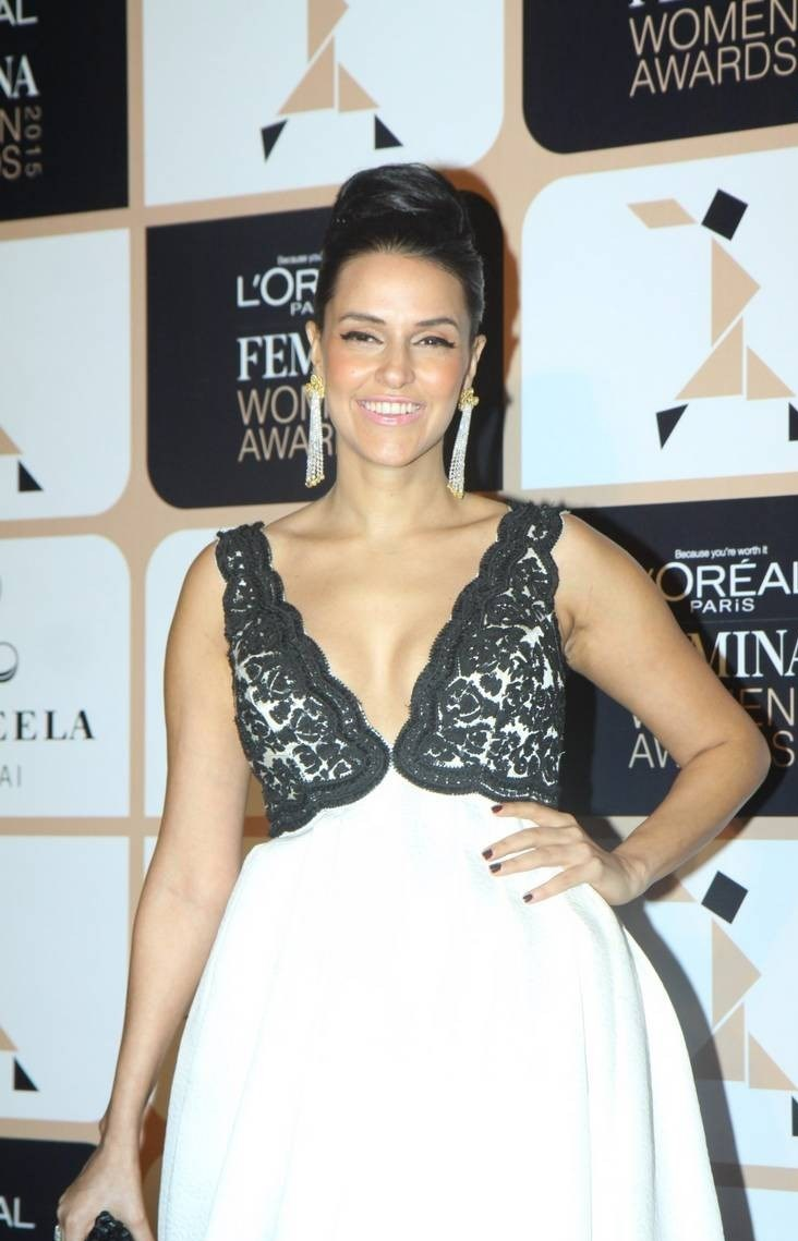 Actress Neha Dhupia shows off her decolletage.
