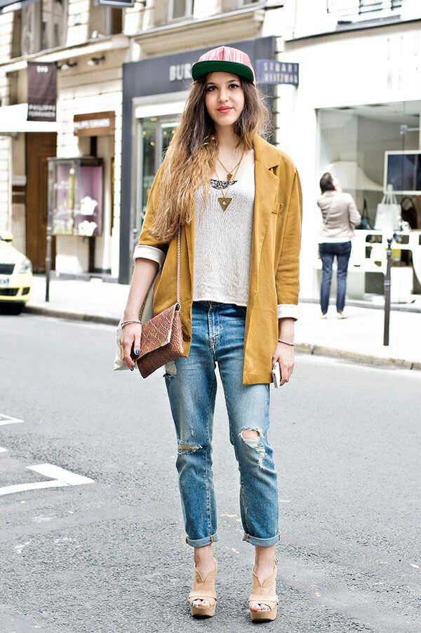 The model in Boyfriend jeans and an autumn toned blazer.