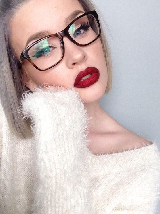 The model is in glasses with curly lashes.