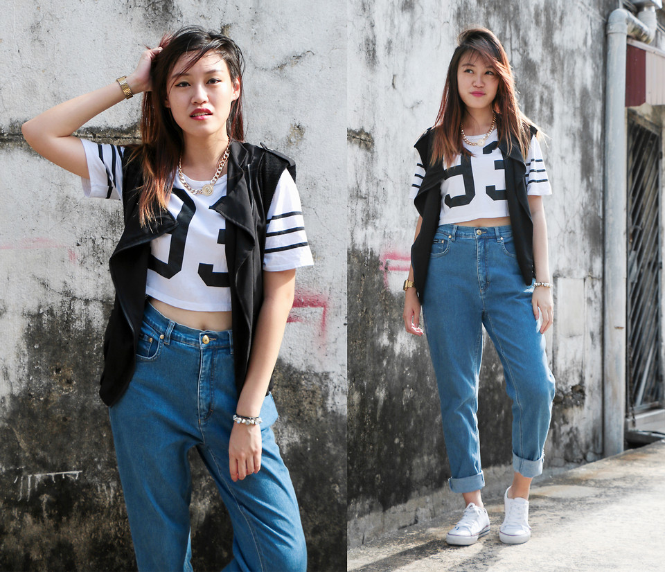 The model in High Waisted Boyfriend Jeans.