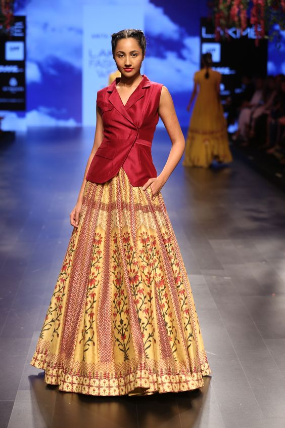 The model in Maroon color blazer with printed Lehenga.
