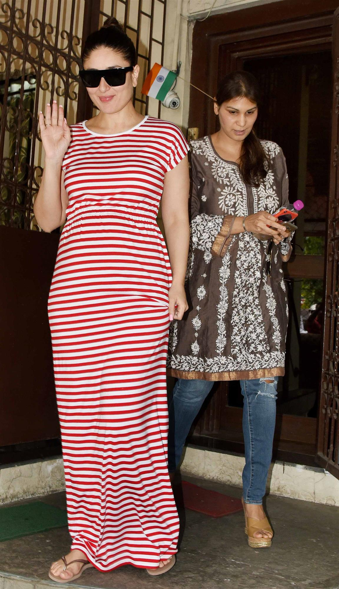 Actress Kareena Kapoor Khan in a red and white striped maxi dress.