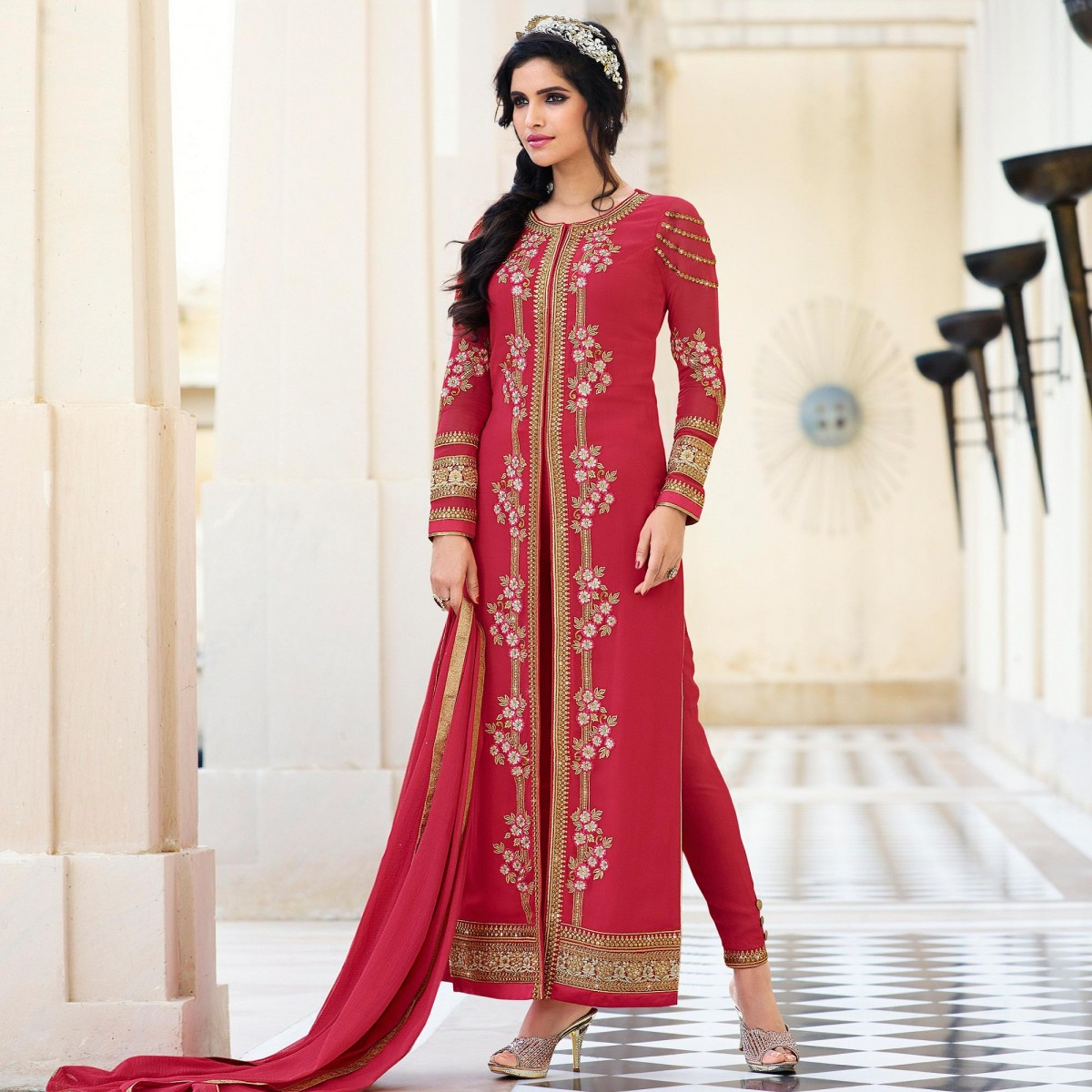 The model is wearing Red High Neck Churidar Suit.
