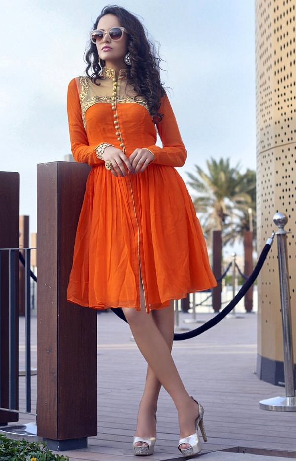 The model is wearing churidar with Illusion Neckline.