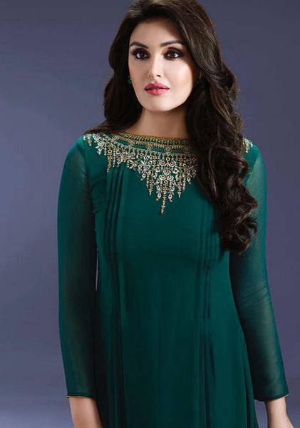 The model is wearing Royal Green Jewel Neck churidar.