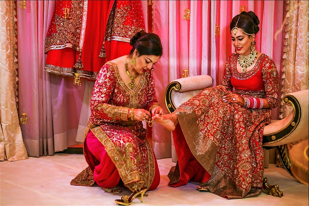 Indian bride's make up and pedicure done by professional.